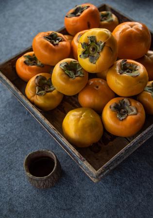 Fresh crisp persimmon Stock Photo - 111011661