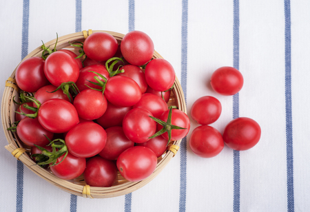 Cherry tomatoes in bamboo basket