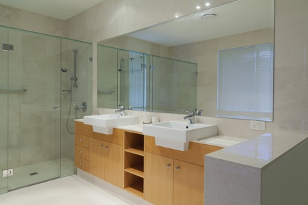 mirror on wall: Modern, stylish twin bathroom Stock Photo