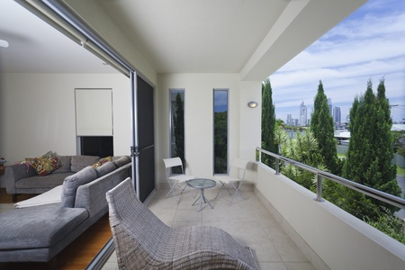 balcony: Stylish balcony with chairs overlooking the city