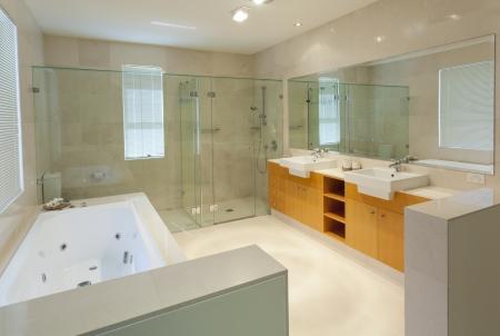 sinks: Modern marble bathroom with twin sinks, shower and bath tub