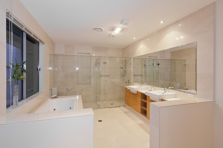 Modern marble bathroom with twin sinks, shower and bath tub photo