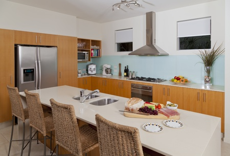 Modern kitchen with food and fruit platter photo