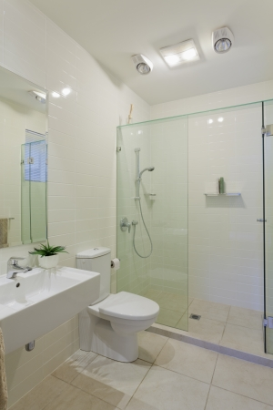 Stylish modern bathroom with shower, sink and toilet Stock Photo