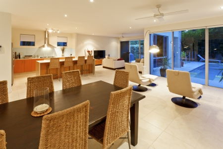 Modern kitchen, living room and dining table photo