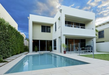 outside of house: Luxurious modern house with swimming pool and backyard