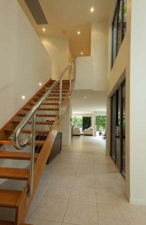 Staircase and hallway in luxurious house photo