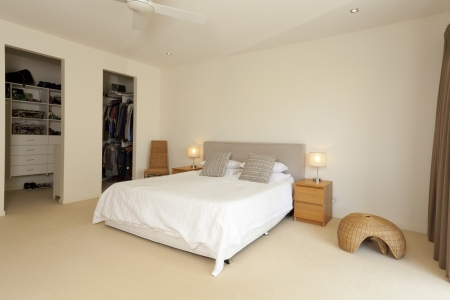 Stylish master bedroom with ensuite photo
