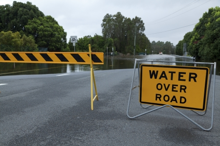 road closed: Flooded australian road with road block Stock Photo