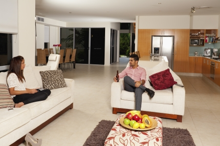 Young couple relaxing in modern living room photo