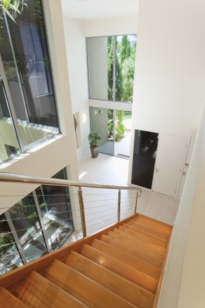 Staircase and entrance in luxurious house photo