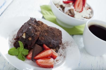 Gluten free brownie, healthy breakfast muesli and black coffee  photo
