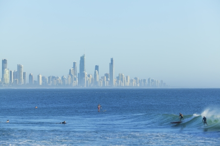 surfers: Sunrise over Surfers Paradise with surfers in foreground Stock Photo