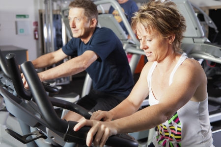 Mature couple working out at fitness centre photo