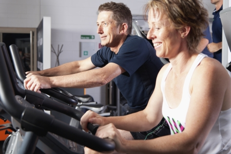 Mature couple wotking out at fitness centre Stock Photo - 13749992