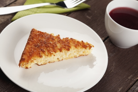 free plate: Gluten free pear and coconut cake with a cup of rosehip tea