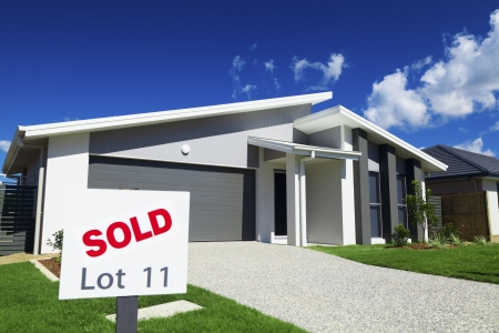 New suburban Australian house with large SOLD sign. photo