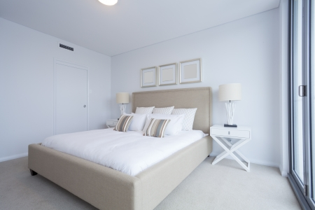 bedside lamp: Stylish master bedroom in new Australian appartment