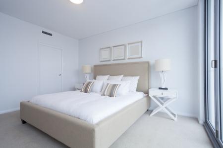 master bedroom: Stylish master bedroom in new Australian appartment