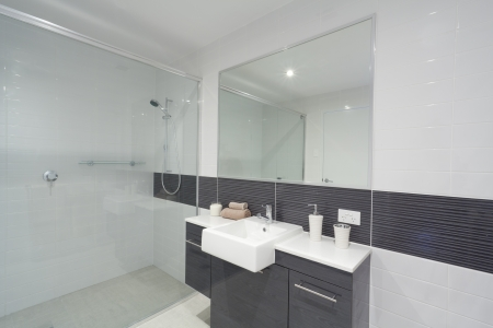 Modern bathroom with shower, sink and mirror  Stock Photo - 14179817