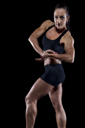fat burning: Female bodybuilder working out isolated on black