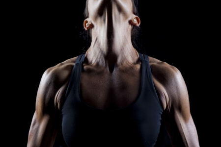 excercise: Female bodybuilder working out isolated on black