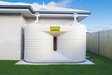rainwater: Large rain water tank in suburban backyard