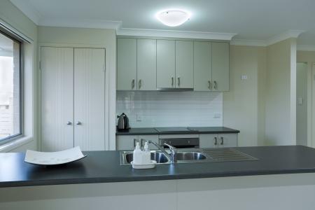 New kitchen in suburban house Stock Photo - 16791389