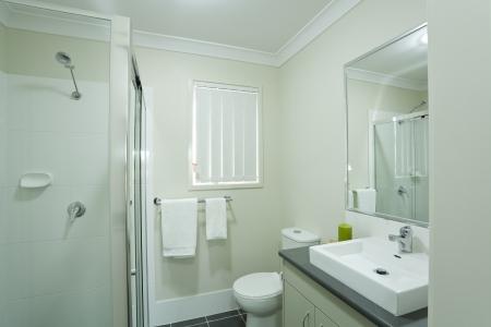 hotel bathroom: New modern bathroom in australian townhouse Stock Photo
