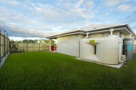 rainwater: Backyard with water tank of Australian townhouse