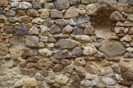 Medieval rock wall in ancient fortress photo