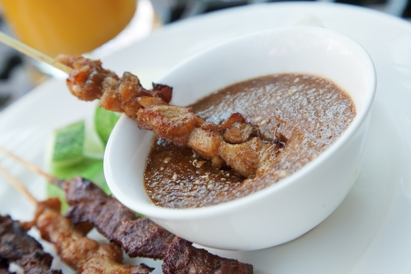 satay sauce: Chicken and beef skewers with satay sauce Stock Photo