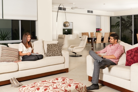 Young couple relaxing in modern living room. photo