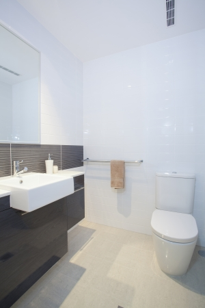 basin: Stylish clean bathroom and toilet Stock Photo
