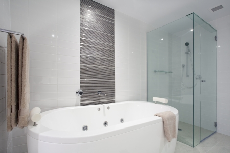 Stylish clean bathroom with shower and bath tub photo
