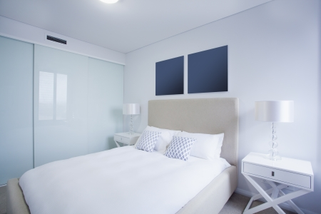 bedrooms: Stylish master bedroom in new Australian apartment.