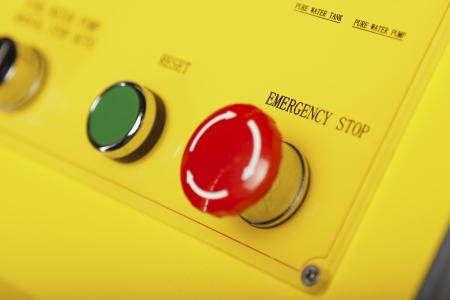 arrestment: Red emergency stop switch and green reset button