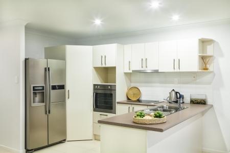 modern lounge: Modern kitchen in suburban house