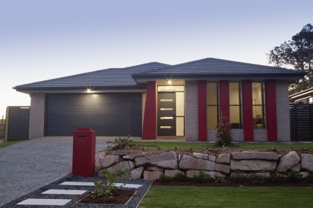 Stylish suburban house front at dusk photo