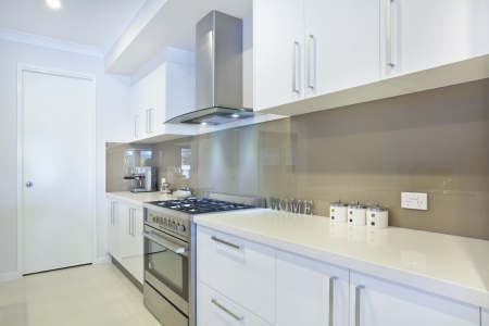 stainless steel kitchen: New modern kitchen with stainless steel appliances Stock Photo