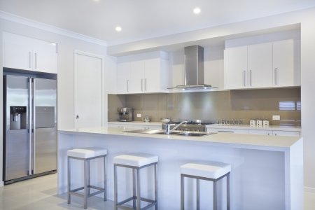 down lights: New modern kitchen with stainless steel appliances Stock Photo