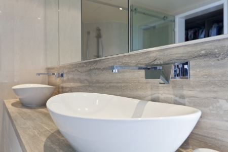 Close up of twin sinks in modern bathroom photo
