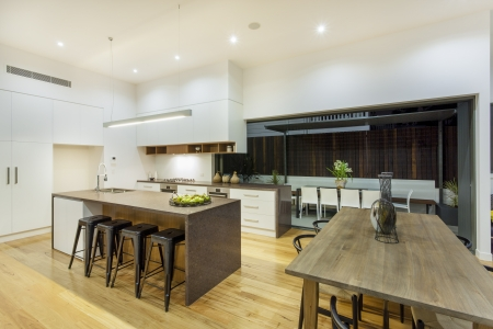 Kitchen and entertainment area in luxury home photo