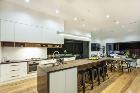 Kitchen and living area in luxury home photo