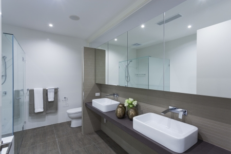 Modern twin bathroom in stylish Australian home photo