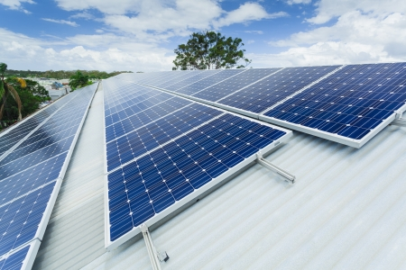 Solar panels on factory roof Stock Photo - 18437260