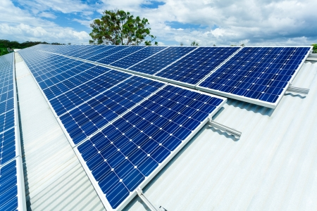 rooftop: Solar panels on factory roof  Stock Photo