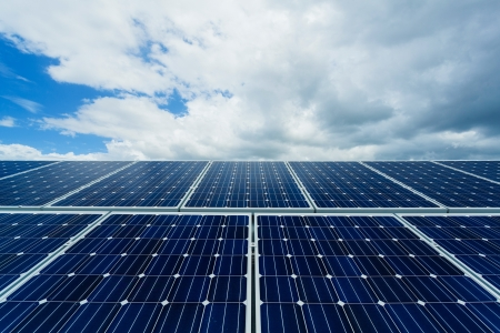 cloud industry: Solar panels on factory roof  Stock Photo