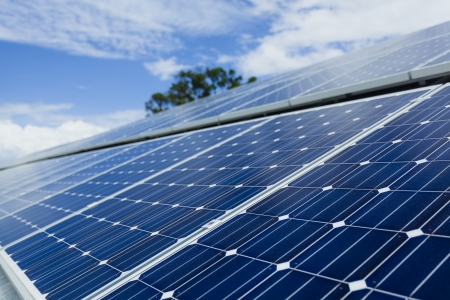 carbon neutral: Solar panels on factory roof  Stock Photo
