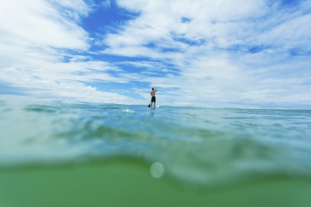 paddle: Stand up paddle boarder on open ocean